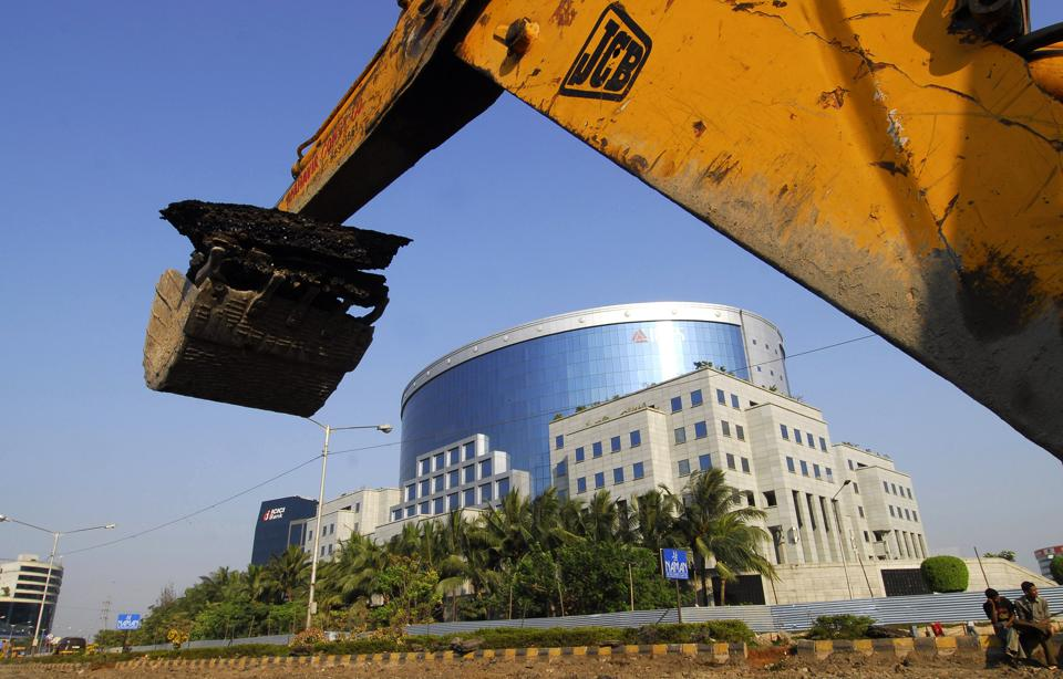 Road construction takes place near the IL&FS building, one of India's leading infrastructure-development and finance companies, in Mumbai.