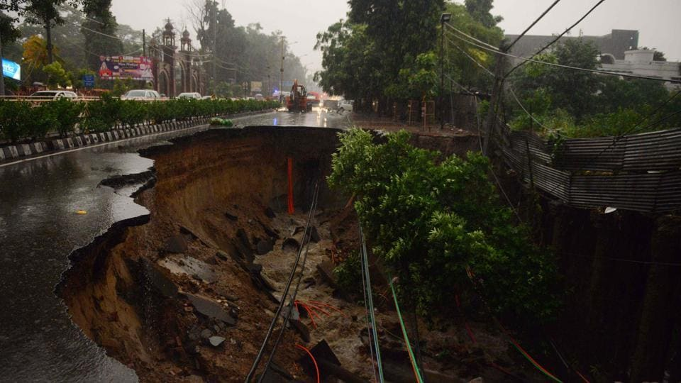 A collapsed road due to heavy rain is seen in Amritsar, Punjab. (Narinder Nanu / AFP)