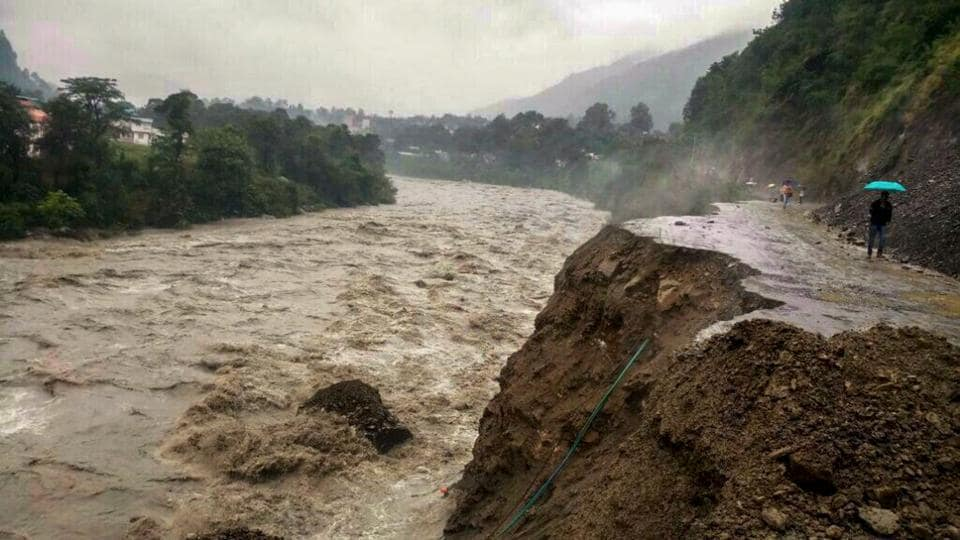 Damaged Pathankot-Chamba highway is seen as heavy gush of flood water flows into Ravi river during incessant rainfall, in Chamba, Himachal Pradesh. (PTI)