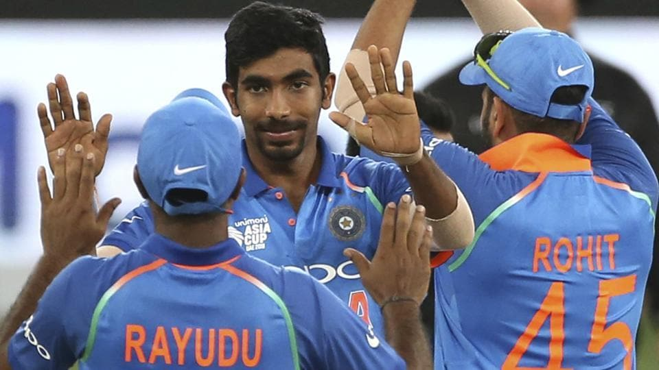 India's Jasprit Bumrah, center, celebrates with teammates during the Asia Cup 2018.
