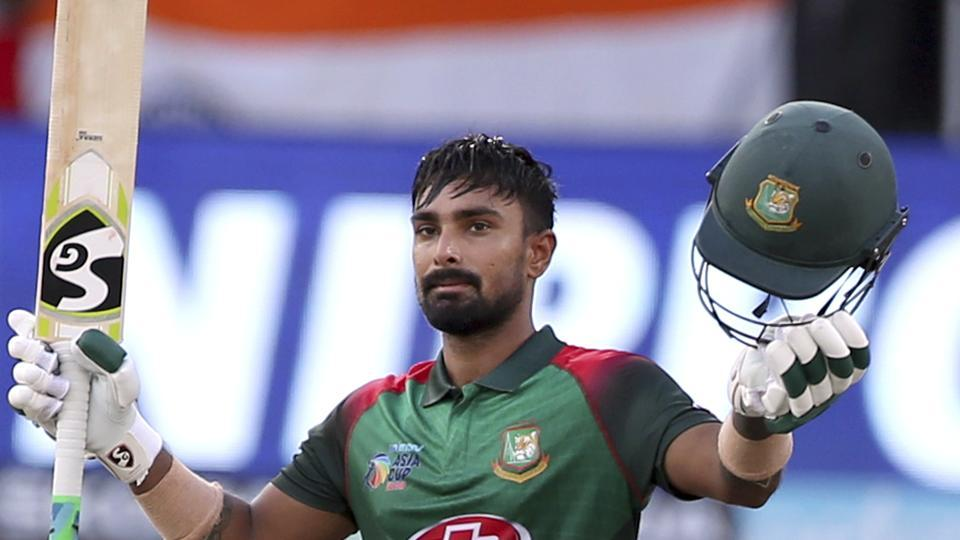 Bangladesh's Liton Das raises his bat and helmet to celebrate scoring a century during the final one day international. (AP)
