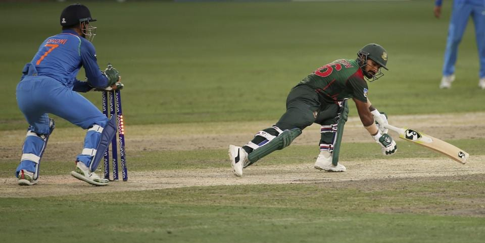India's wicketkeeper Mahendra Singh Dhoni, left, stumps out Bangladesh's Liton Das, right, during the final one day international cricket match. (AP)