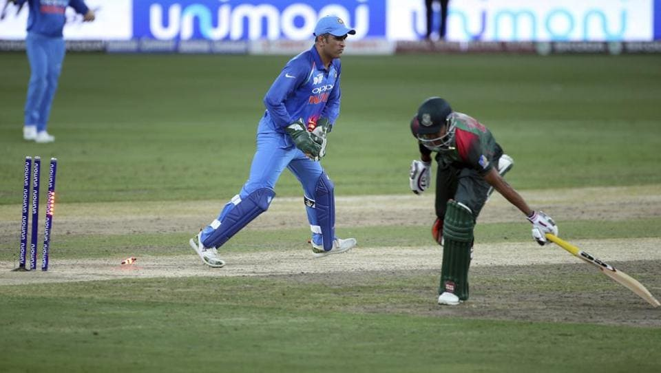 Bangladesh's Soumya Sarkar, right, is run-out by India's wicketkeeper Mahendra Singh Dhoni. (AP)