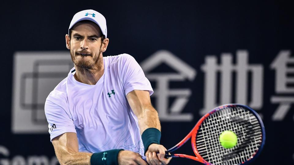 Andy Murray of Britain hits a return during his men's singles match against Fernando Verdasco of Spain at the ATP Shenzhen Open tennis tournament.