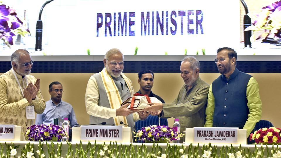 Prime Minister Narendra Modi being facilitated by Ram Bahadur Rai as Prakash Javadekar and Sachidananda Joshi look on during a conference on 'Academic Leadership on Education for Resurgence', at Vigyan Bhavan in New Delhi on Saturday.
