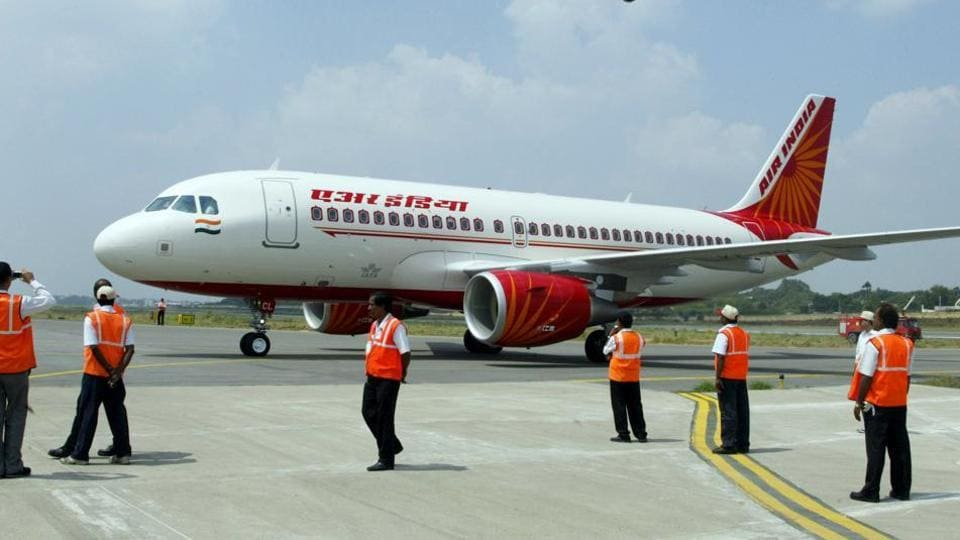 Ground crew standing next to a newly-inducted Air India Airbus A319 aircraft at Begumpet Airport in Hyderabad.