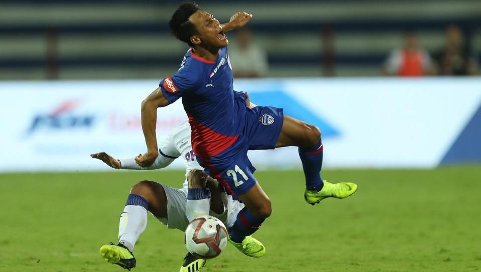 Jerry Lalrinzuala of Chennaiyin FC fouls Udanta Singh of Bengaluru FC during their Indian Super League (ISL)encounter.