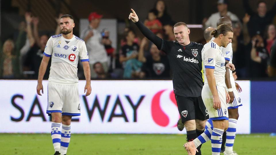 D.C. United forward Wayne Rooney (in black) celebrates after scoring a goal against Montreal Impact.