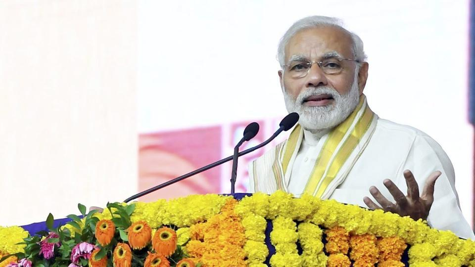 Prime Minister Narendra Modi addresses a public meeting at the inauguration of Mahatma Gandhi Museum and several other development projects,in Rajkot on September 30.