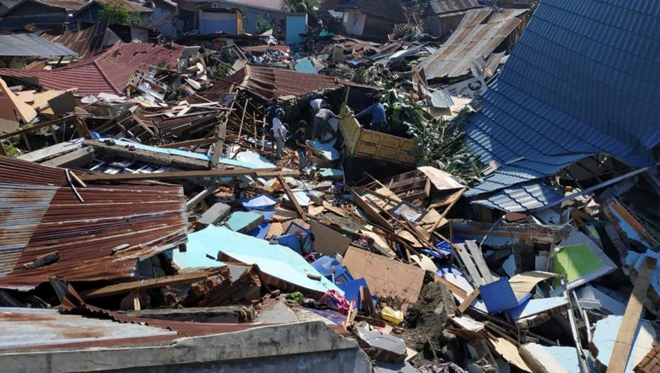 People search through debris in a residential area following an earthquake and tsunami in Palu, Central Sulawesi, Indonesia September 30, 2018 in this photo taken by Antara Foto.