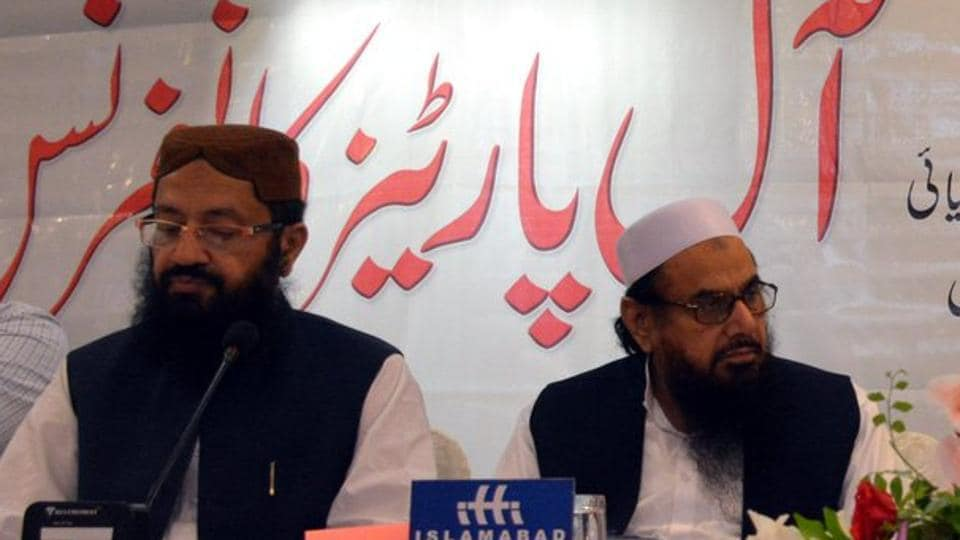 Hafiz Saeed (right) and Pakistan's religious affairs minister Noor-Ul-Haq Qadri were seen together at an event in Islamabad.