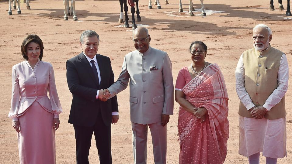 Uzbekistan's President Shavkat Mirziyoyev meets with President Ramnath Kovind (C) as Ziroatkhon Hoshimova (L), Savita Kovind (2R) and Prime Minister Narendra Modi (R) look on, during Mirziyoyev's reception at the forecourt of Rashtrapati Bhavan. India and Uzbekistan will jointly work together and strive for a stable, prosperous and peaceful Afghanistan, said PM Modi on Monday. (Ajay Aggarwal / HT Photo)
