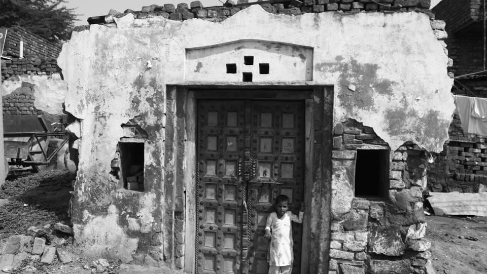 Ghasera, 45 km southwest of Gurgaon, is no ordinary village, though governmental neglect is as evident as in any other region of Mewat—one of Haryana's most backward districts. Inhabitants here still live on the legacy of Mahatma Gandhi who visited at the time of Partition and convinced them not to migrate to Pakistan. 71 years on, residents are still waiting for the 'Gandhi fame' to bring them good fortunes. (Yogendra Kumar / HT Photo)
