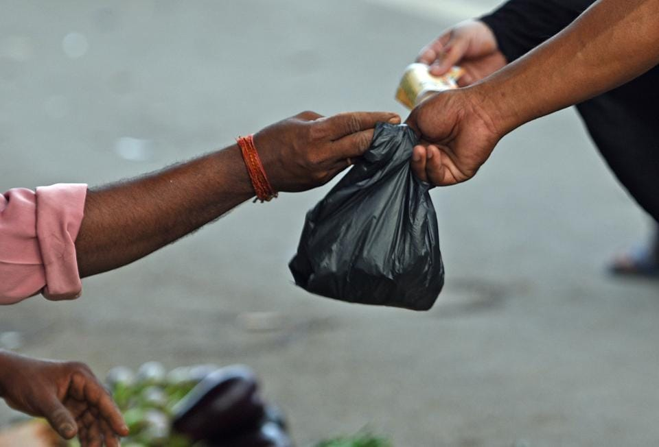 Shopkeepers use plastic bags after the statewide ban in Bandra.