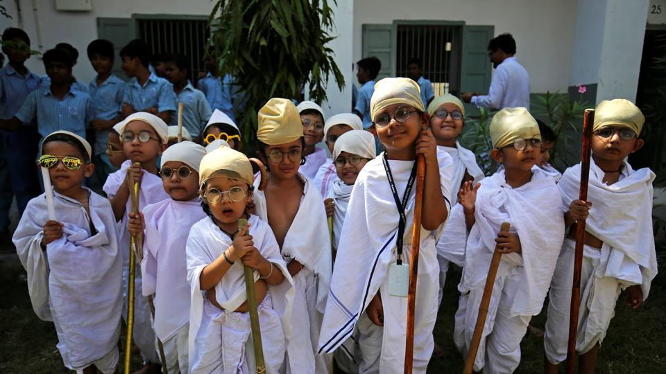 Students dressed as Mahatma Gandhi take part in an event to mark Gandhi's 150th birth anniversary, at a school in Ahmedabad. (Amit Dave / REUTERS)