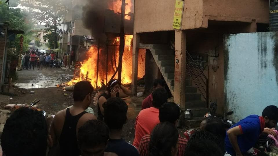 A fire broke out from a transformer in Shivshambho society located in Jai Malhar Nagar of Thergaon on Saturday. Three people were injured in the explosion of a transformer and a tempo and a bike standing near the transformer were burnt. (HT PHOTO)