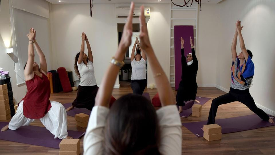 Nouf Marwaai, 38, the head of the Arab Yoga Foundation (foreground), instructs her students at her studio in the western Saudi Arabian city of Jeddah. In a sparse, wood-floored studio, Saudi women squat, lunge and do headstands. Even a year ago, teaching these yoga postures could have rendered them outlaws in the conservative Islamic kingdom. (Amer Hilabi / AFP)