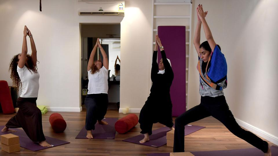 """Five years ago, this (teaching yoga) would have been impossible,"" added Marwaai, as she began training a cluster of women students at a private studio in the Red Sea city of Jeddah. Hanging up their body-shrouding abayas and headscarves, the women stretched in unison in an arching warrior pose known as ""virabhadrasana"". (Amer Hilabi / AFP)"