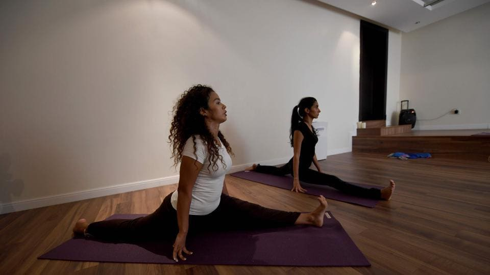 "In a country where women have long been denied the right to exercise publicly, the students -- some of whom regularly attend yoga retreats in India -- said it had transformed their lives, also working as therapy, helping vent emotions and tackle a woefully common ailment -- depression. ""It just opened me up like a water balloon,"" said Yasmin Machri (L). ""After my first class... I started breaking down and crying."" (Amer Hilabi / AFP)"