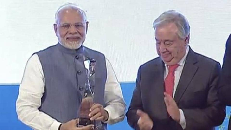 Prime Minister Narendra Modi receives the Champion of the Earth award from UN Secretary General Antonio Guterres in New Delhi.