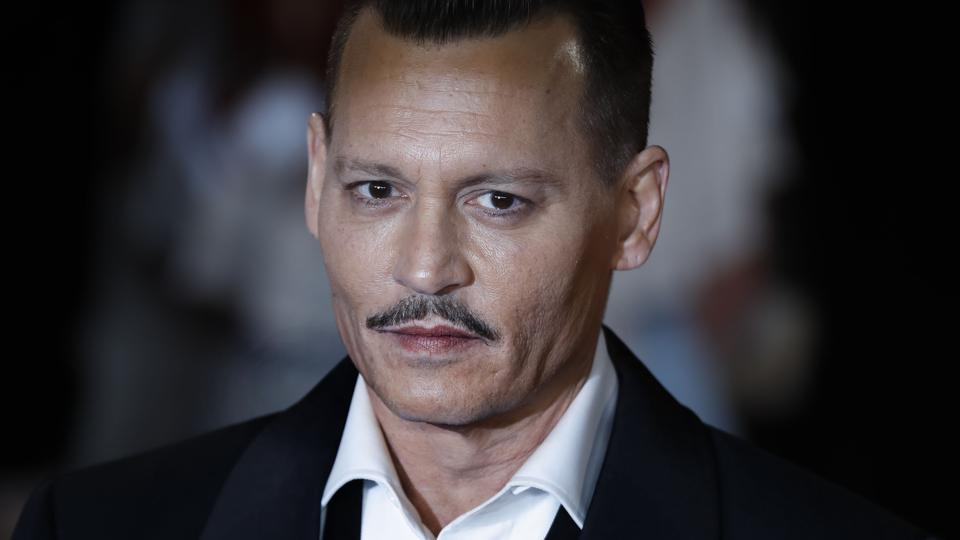 In this file photo taken on November 2, 2017 US actor Johnny Depp poses upon arrival to attend the world premiere of the film Murder on the Orient Express at the Royal Albert Hall in west London.