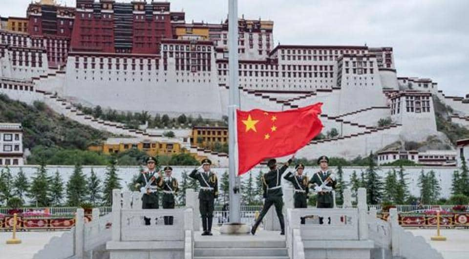 The Chinese national flag is raised during a ceremony marking the 96th anniversary of the founding of the Communist Party of China (CPC) at Potala Palace in Lhasa, Tibet Autonomous Region, China, in July  2017.