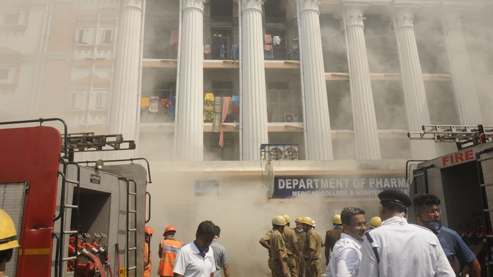 Hundreds of patients were evacuated safely on Wednesday after a fire broke out in the pharmacy building of the Kolkata Medical College and Hospital, officials said. At least ten fire engines were pressed into service after the fire was noticed at around 8am in the building of the hospital, the oldest institute of western medicine in the country, located on College Street. (Samir Jana / HT Photo)