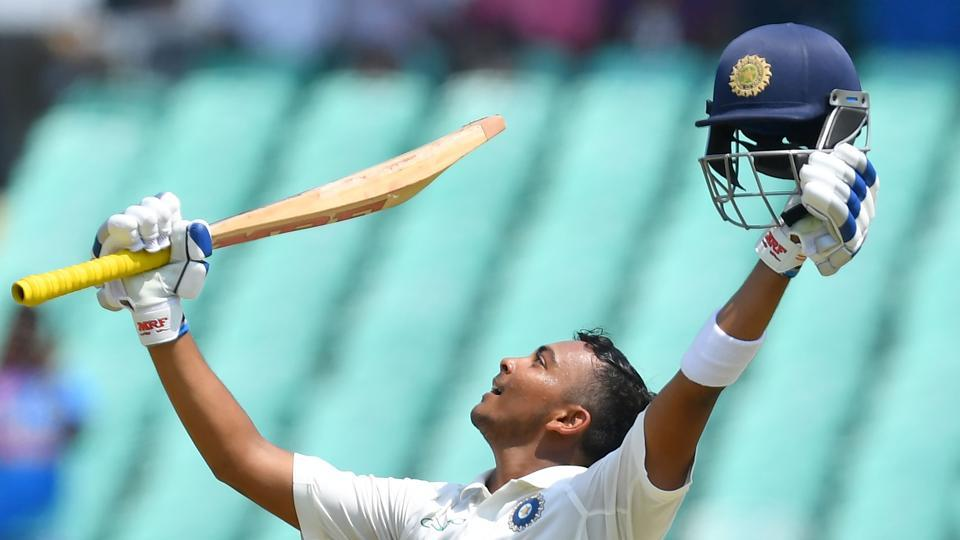 India's Prithvi Shaw celebrates after scoring a century (100 runs) during the first of the first Test cricket match between India and West Indies at the Saurashtra Cricket Association stadium in Rajkot. (AFP)
