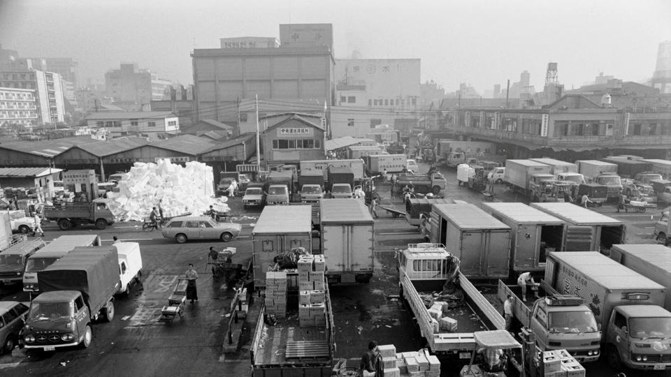 People work at the Tsukiji market on October 27, 1977. The 83-year-old market, a popular tourist attraction, is a warren of shops and warehouses where small turret trucks zip around laden with ice-filled boxes of fish. But city officials have said it has become dilapidated and unsanitary. (Tokyo Metropolitan Government/Handout via REUTERS)