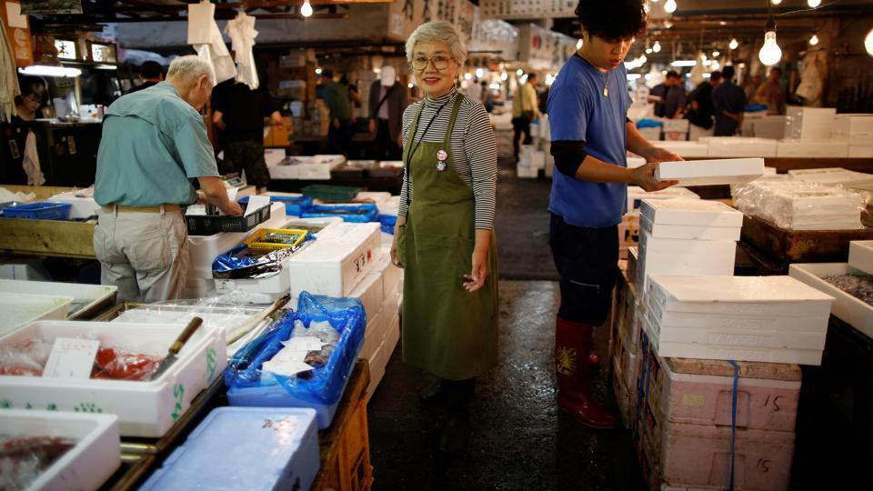 Yamaguchi, who has been tending her family's fish shop for more than 50 years poses at Tukiji market. In a last-ditch bid to delay the move, 56 traders sued the city of Tokyo last month, seeking a temporary injunction. They have asked the court to rule before Tsukiji closes on Saturday. If there are no delays, business will resume at the new Toyosu market on October 11, but traders worry customers will not follow them. (Issei Kato / REUTERS)