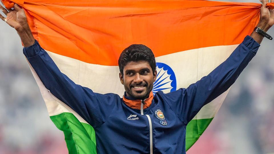 Jinson Johnson celebrates during the medal ceremony for the men's 1500m event in Jakarta.