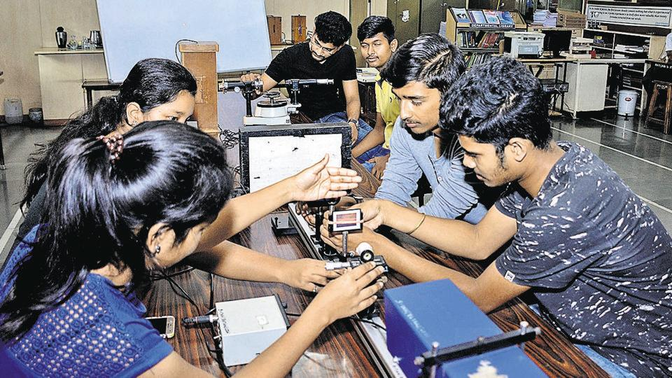 Students of MIT college perform an experiment on Laser in the Physics lab on Thursday.  The book, Bharatiya Vidya Saar, claims that Rigveda accurately mentions the speed of light.