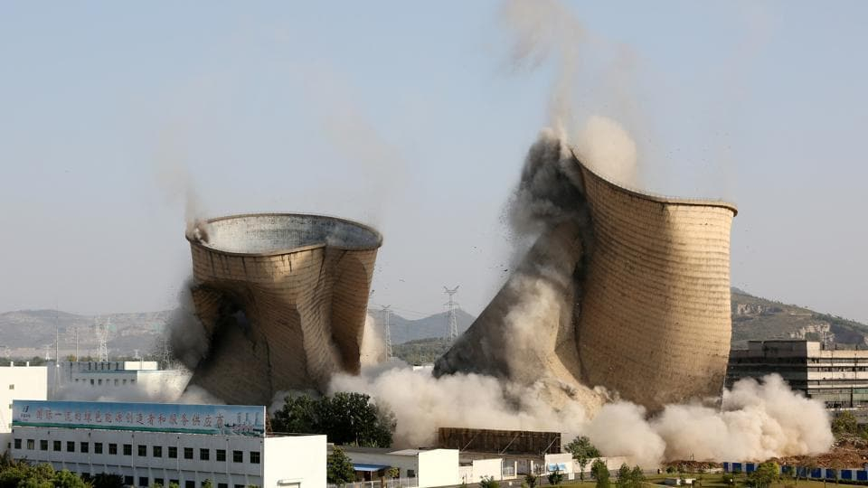 Cooling towers collapse during a controlled demolition at Huadian Shiliquan power plant in Zaozhuang, Shandong province, China. (REUTERS)