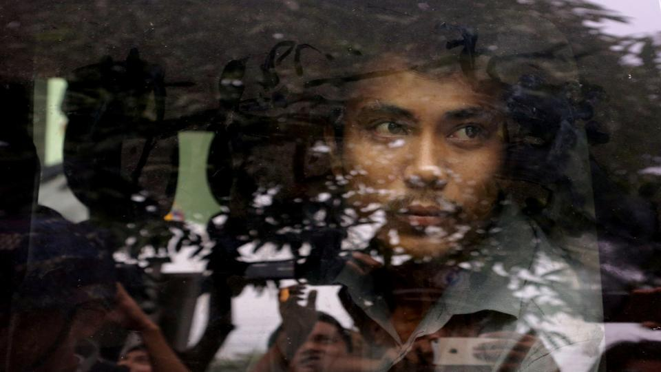 Detained Reuters journalist Kyaw Soe Oo leaves after a court hearing in Yangon, Myanmar. (Ann Wang / REUTERS)