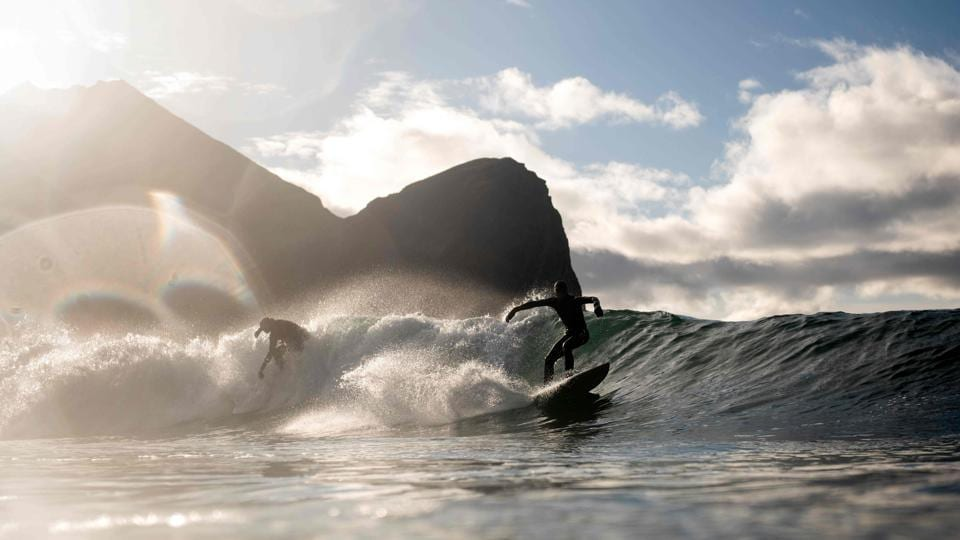 Surfer ride waves, in Unstad, northern Norway, on the first day of the Lofoten Masters 2018. (Olivier Morin / AFP)
