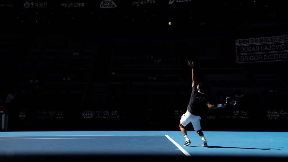 Grigor Dimitrov of Bulgaria serves during his men's singles second round match against Serbia's Dusan Lajovic at the China Open tennis tournament in Beijing. (Fred Dufour / AFP)