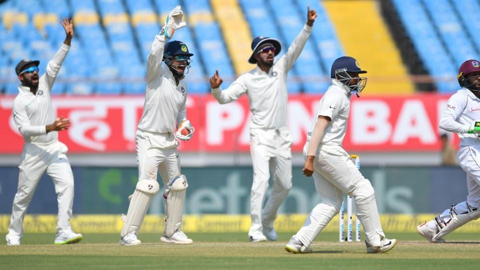 (L-R) Indian cricketers Ajinkya Rahane, Richabh Pant, KL Rahul and Prithvi Shaw appeal successfully for a caught behind against West Indies Batsman Devendra Bishoo (R) during the third day's play of the first Test cricket match between India and West Indies at the Saurashtra Cricket Association Stadium in Rajkot  (AFP)