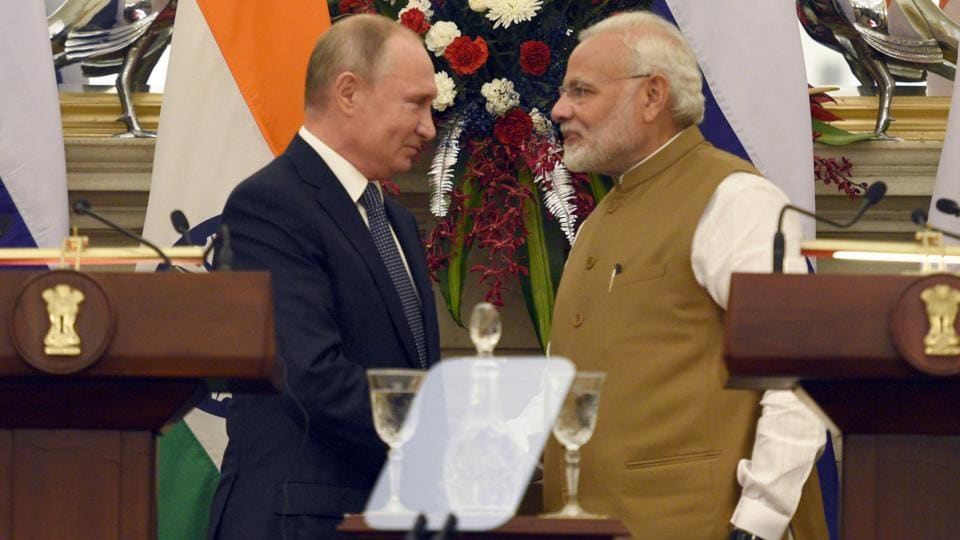 Prime Minister Narendra Modi shake hands with Russian President Vladimir Putin after delivering a joint press statement, at Hyderabad House, in New Delhi, India, Friday, Oct. 5, 2018.