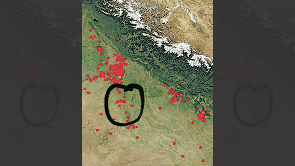 Red dots, appearing on the Nasa's Fire Information for Resource Management System, indicate any kind of active fires, including stubble burning in northwest India, forest fires and even garbage burning.