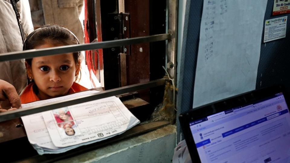 A girl waits for her turn to enrol for Aadhaar at a registration centre in Delhi on January 17, 2018.