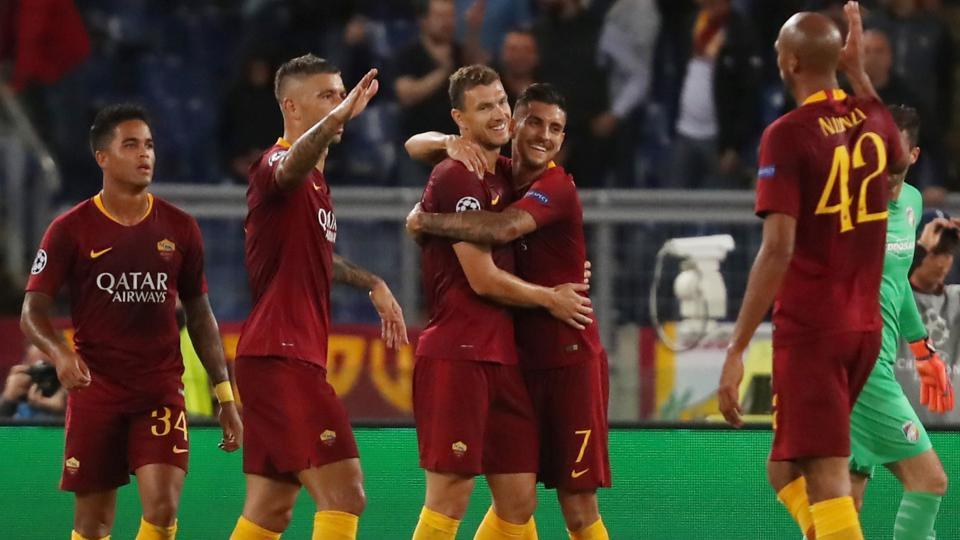 Roma's Edin Dzeko celebrates scoring their second goal with Lorenzo Pellegrini and team mates.