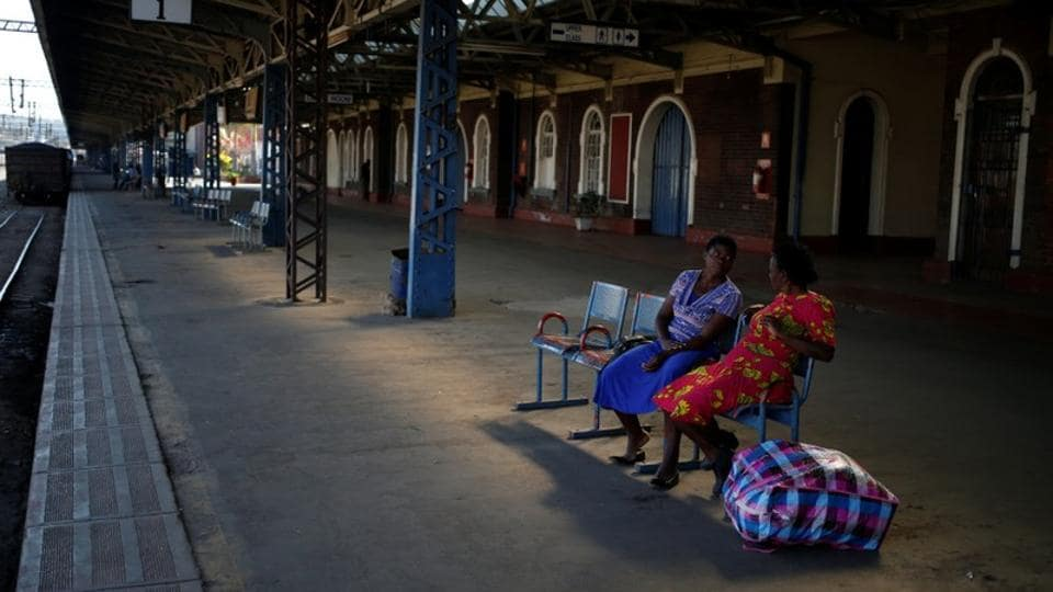 Passengers chat as they wait for a train at a station in Harare. It was once the preferred mode of transport for most Zimbabweans. The state-run rail service now mirrors the decline in the country's economic fortunes during the last two decades under the leadership of former President Robert Mugabe. (Siphiwe Sibeko / REUTERS)