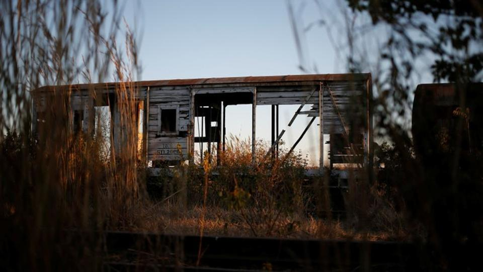 An abandoned train carriage stands in Harare. The signalling and information systems are often vandalised and some tracks overgrown with grass and weeds because they have not been used in years. (Siphiwe Sibeko / REUTERS)