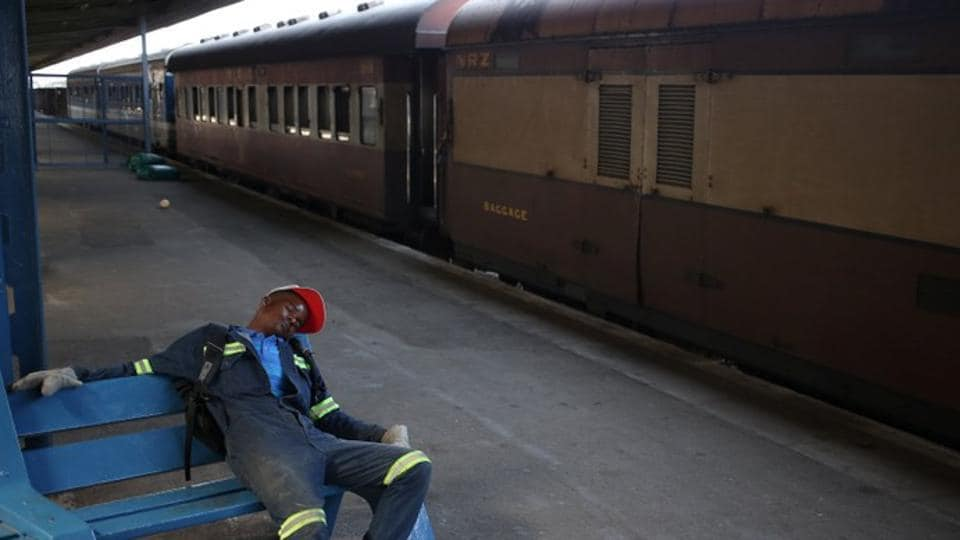 A train mechanic sleeps at a platform after an overnight train journey from Harare, in Bulawayo, Zimbabwe. Dark, dirty and slow, the country's trains, like much else in the impoverished southern African nation, have seen better days. (Siphiwe Sibeko / REUTERS)