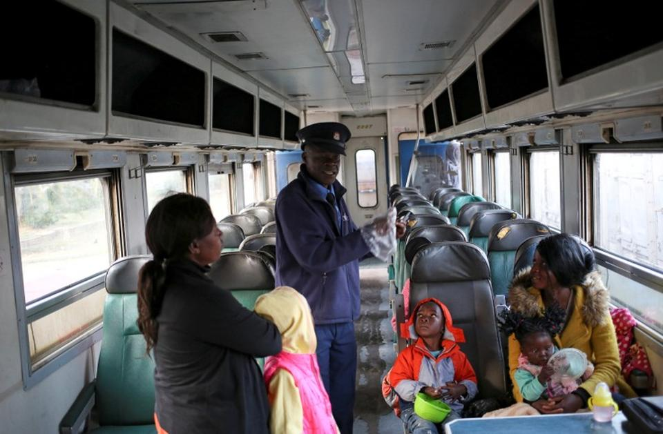 A train inspector speaks to passengers on a sleeper train travelling from Harare to Bulawayo. Last year South African logistics group Transnet won a $400 million joint bid to recapitalise NRZ and fix some of the problems, including acquiring and refurbishing carriages. (Siphiwe Sibeko / REUTERS)