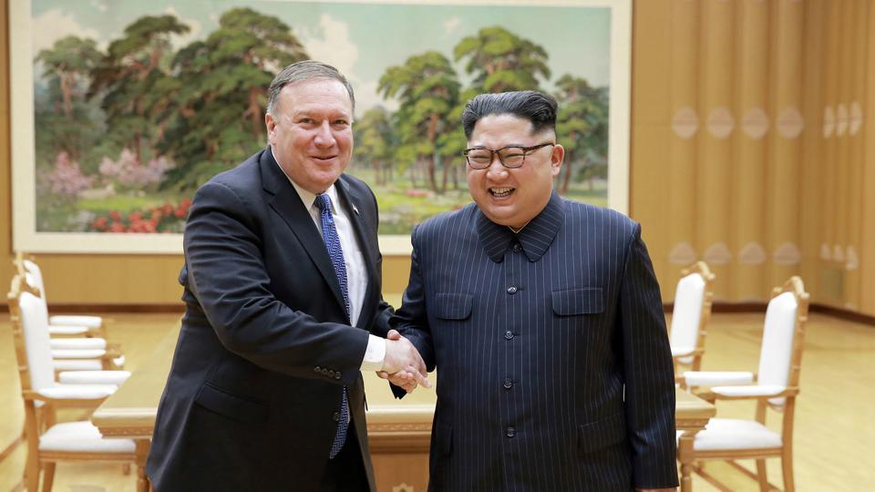 In this May 9, 2018 photo, US secretary of state Mike Pompeo, left, shakes hands with North Korean leader Kim Jong Un during a meeting at Workers' Party of Korea headquarters in Pyongyang, North Korea.
