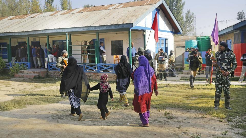 Women arrive to cast their vote in Hamdaniya colony area of Srinagar, Jammu and Kashmir on October 8.