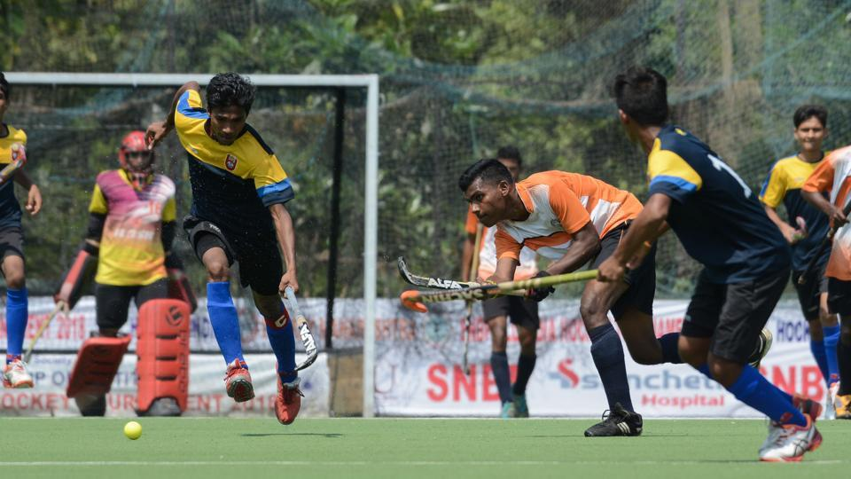 Hockey match played between SNBP academy Pune(in orange and white)and Krida Prabhobini Pune(in blue and yellow) at balewadi stadium, Pune on October 6. (Milind Saurkar/HT Photo)