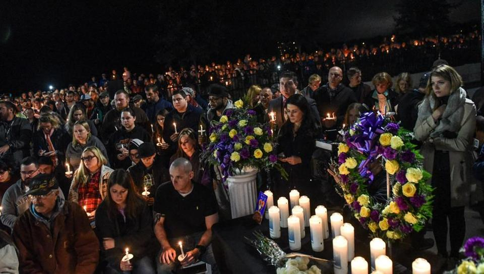 Mourners attend a candlelight vigil for the victims of the fatal limousine crash on October 8, 2018 in Amsterdam, New York.