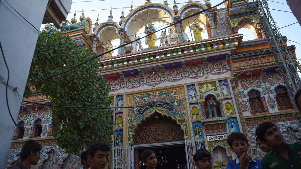 As they enter Shri Krishna temple, the Hindu faithful ring a bell, the sound minglng with the azan, sounded just a few streets away. A relaxed group of young Hindus talk outside the colourful, intricately carved exterior, where not a single guard is employed, in sharp contrast to the Hindu neighbourhoods in the megacity of Karachi, some 300 kilometres away, which are under armed surveillance. (Rizwan tabassum / AFP)